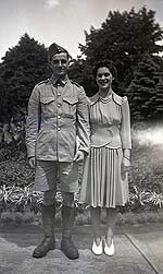 Man in military uniform with woman.